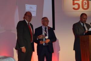 Wilf Butcher receives his award from Chairman Martin Harvey