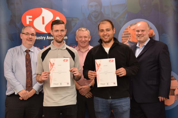 The first two people to achieve a qualification are presented certificates