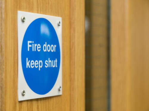 Fire doors and fire safety signs make up only part of the total fire protection a building requires